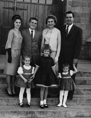 The Brown Family on the steps of the Cathedral of the Ozarks, circa 1960: Karen, John III, Caroline, John Jr., Julie, Melinda, Laurie (courtesy of Brown family).